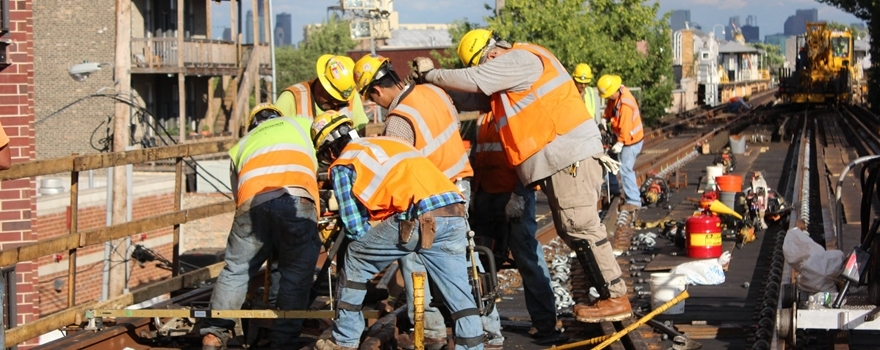 Workers replacing track on Milwaukee Ave Elevated Blue Line improvements