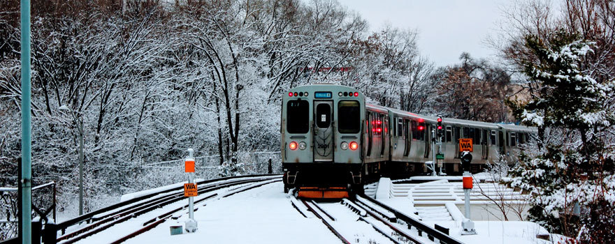A Blue Line train leaving Forest Park in snow