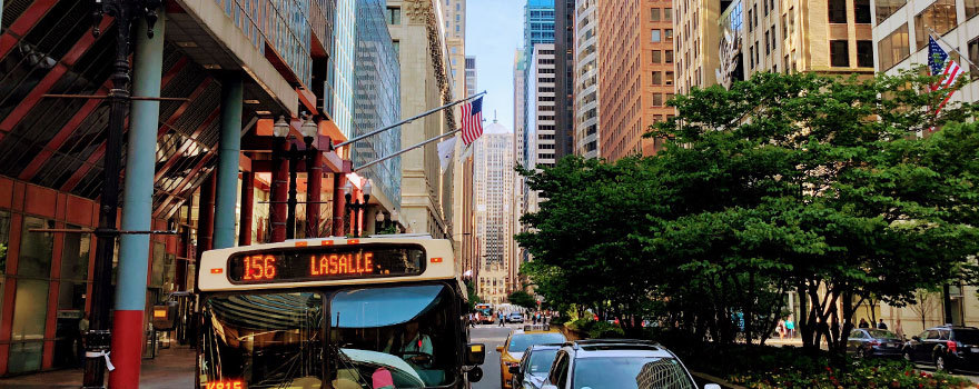 A bus on LaSalle street with the Chicago Board of Trade in the background