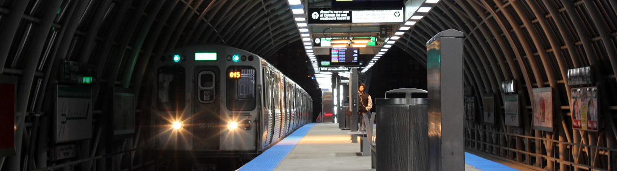A dramatic photo of the Cermak-McCormick Place platform at night on its opening weekend